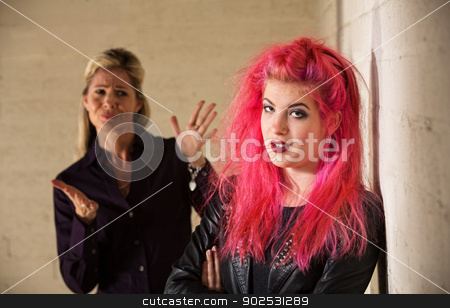 Aggravated Parent with Child stock photo, Angry mother with frustrated daughter in pink hair by Scott Griessel