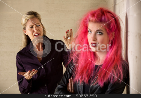 Bickering Family stock photo, Angry mother with teenage daughter in leather jacket by Scott Griessel