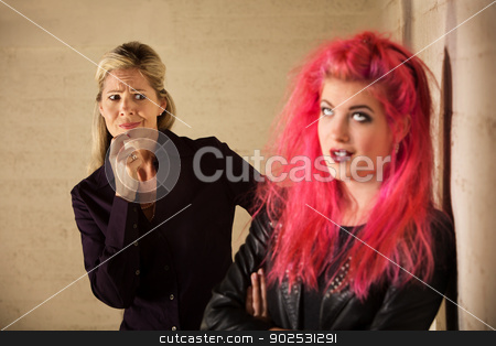 Suspicious Mother with Daughter stock photo, Suspicious blond mother with annoyed teenage daughter by Scott Griessel