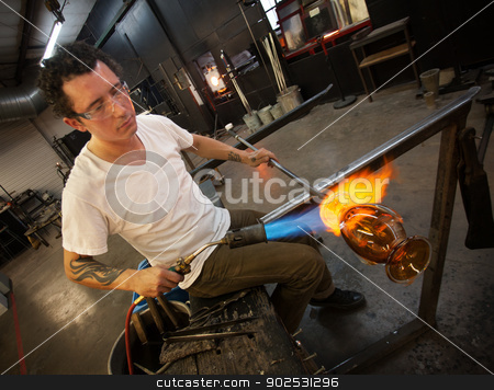 Adult Glass Artist Working stock photo, Adult male working in glass artist studio with blowtorch by Scott Griessel