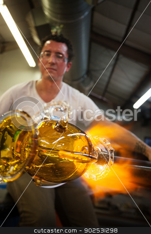 Artists Sculpting Glass stock photo, Latino glass artist sculpting glass vase with blowtorch by Scott Griessel
