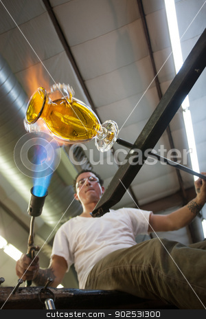 Artist Creating a Vase stock photo, Industrial artist creating a yellow glass vase by Scott Griessel