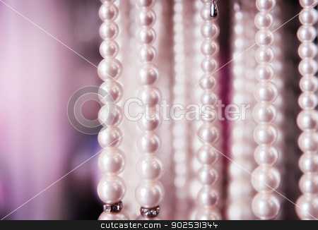 pearl necklaces for sale stock photo, fake pearl necklaces hanging for sale in shop by Phil Morley