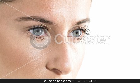 Beauty face close up stock photo, Woman Blue Eyes close up Looking down with white Background by ABBPhoto