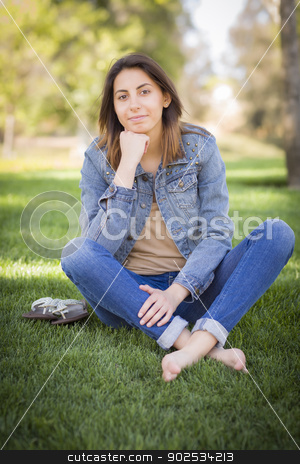 Beautiful Mixed Race Young Woman stock photo, Beautiful Mixed Race Young Woman Portrait Outside In The Grass. by Andy Dean