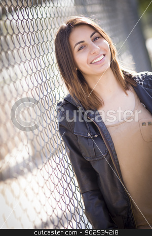 Beautiful Mixed Race Young Woman stock photo, Beautiful Mixed Race Young Woman Portrait Outside Against Chain Link Fence. by Andy Dean