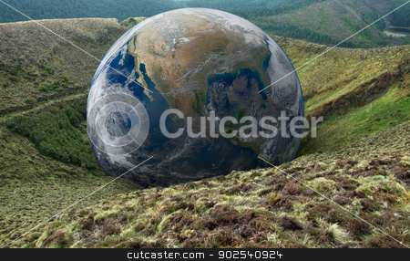 global downfall stock photo, terrestrial globe on hilly overgrown ground by prill