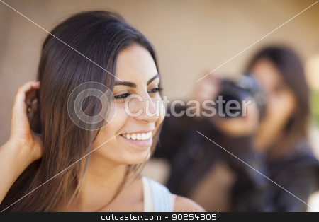 Young Adult Mixed Race Female Model Poses for Photographer stock photo, Attractive Young Adult Mixed Race Female Model Poses for a Photographer Outside. by Andy Dean