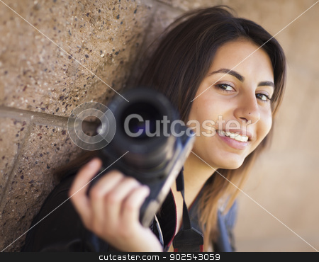 Mixed Race Young Adult Female Photographer Holding Camera stock photo, Attractive Mixed Race Young Adult Female Photographer Against Wall Holding Camera. by Andy Dean