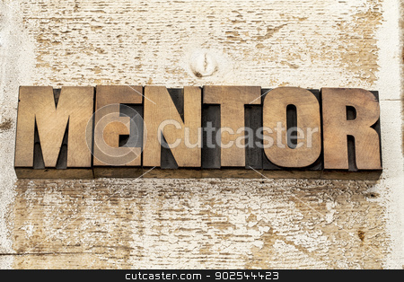 mentor word in wood type stock photo, mentor word in vintage letterpress wood type blocks against grunge white painted barn wood by Marek Uliasz