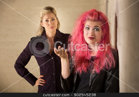 Punk Teen Ignoring Parent stock photo, Rude child with frustrated parent in background by Scott Griessel