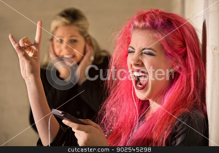 Obnoxious Girl Singing stock photo, Woman covering ears while teenage girl sings by Scott Griessel