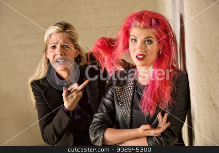 Upset Mother with Teen Hairdo stock photo, Upset mother holding teenage girls pink hair by Scott Griessel