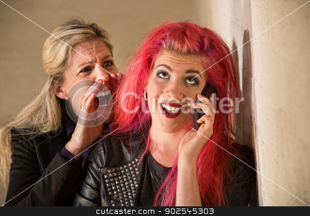 Yelling at Teenage Girl on Phone stock photo, Mature woman yelling to ear of teenager on phone by Scott Griessel