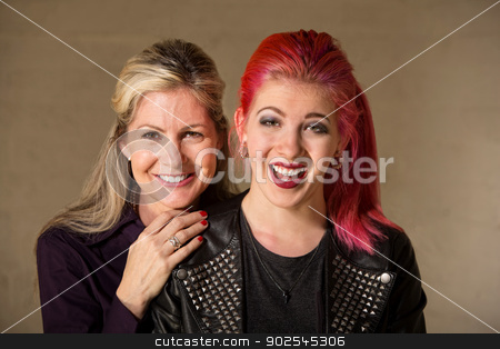 Laughing Mother and Daughter stock photo, Laughing beautiful European mother and daughter indoors by Scott Griessel