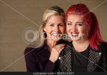 Happy Mother and Daughter stock photo, Cheerful teenage female with blond mother indoors by Scott Griessel