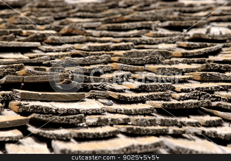 Old Roof stock photo, Old brown dry rotted roof shingles. by Henrik Lehnerer