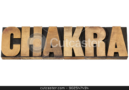 chakra word in wood type stock photo, chakra word - life force or vital energy concept - isolated text in letterpress wood type printing blocks by Marek Uliasz