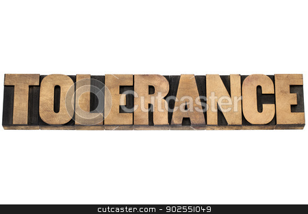 tolerance word in wood type stock photo, tolerance word - isolated text in letterpress wood type printing blocks by Marek Uliasz