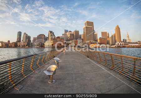 San Francisco in fish eye stock photo, San Francisco cityscape with Ferry Terminal at sunrise from Pier 14 with metal swivel chairs, distorted fish eye perspective from Pier 14 by Marek Uliasz