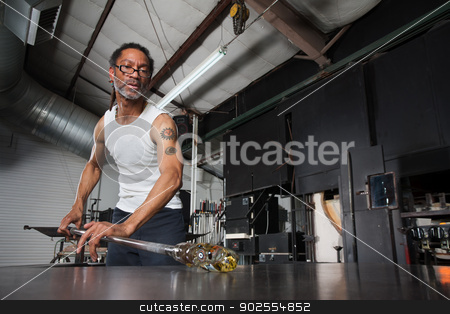 Busy Glass Artisan Working stock photo, Busy glass artisan with fine art object on workbench by Scott Griessel