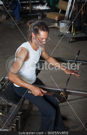 Man Working on Glass Art stock photo, Handsome Black man working on fine art glass jar by Scott Griessel