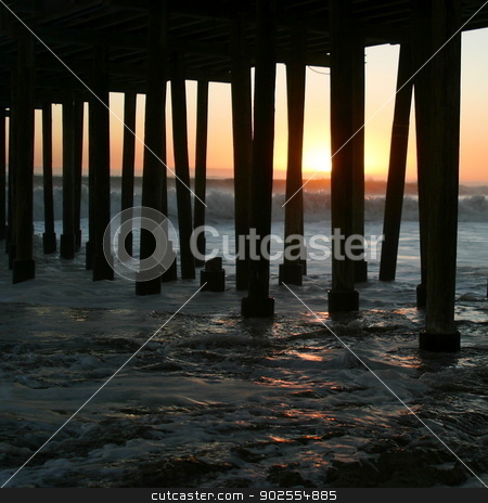 Sunset Under The Pier stock photo, Watching the sunset under the Ventura pier. by Henrik Lehnerer