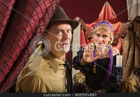 Scared Man with Fortune Teller stock photo, Scared businessman and fortune teller displaying the evil eye by Scott Griessel