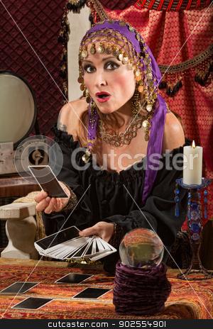 Startled Tarot Card Reader stock photo, Startled tarot card reader with crystal ball and candle by Scott Griessel