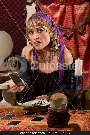 Concerned Tarot Card Lady stock photo, Nervous Caucasian female fortune teller with tarot cards by Scott Griessel