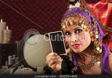 Serious Fortune Teller stock photo, Serious gypsy fortune teller explaining tarot card in her hand by Scott Griessel