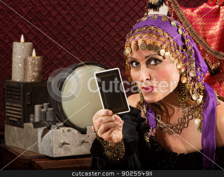Cute Tarot Card Reader stock photo, Cute fortune teller in ornate dress with tarot card by Scott Griessel