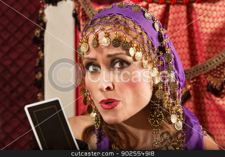 Worried Fortune Teller stock photo, Worried European gypsy fortune teller with tarot card by Scott Griessel