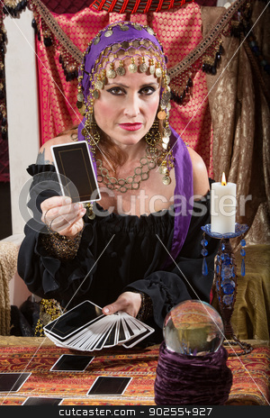 Woman Dealing Tarot Cards stock photo, Pretty Romani woman dealing blank tarot cards by Scott Griessel