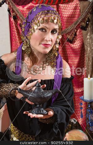 Fortune Teller Rubs the Lamp stock photo, Pretty female gypsy fortune teller rubs a magic lamp by Scott Griessel