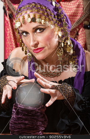 Waving Over a Crystal Ball stock photo, Pretty lady waving hands over crystal ball by Scott Griessel