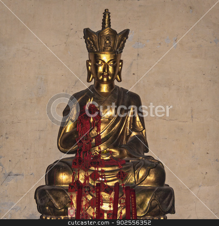 Golden Statue of Vikirna in Buddhist Temple, Beijing stock photo, Golden Statue of Vikirna against wall in Buddhist Temple, Beijing, China by Bryan Mullennix