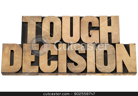 tough decision stock photo, tough decision - isolated text in letterpress wood type printing blocks by Marek Uliasz
