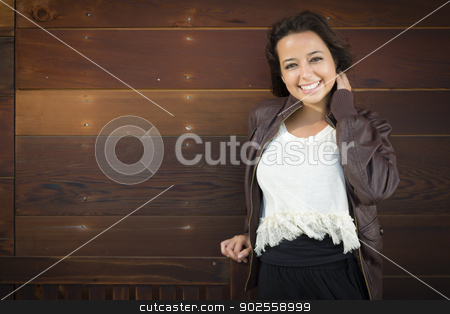 Mixed Race Young Adult Woman Portrait Against Wooden Wall stock photo, Portrait of a Pretty Mixed Race Young Adult Woman Against a Lustrous Wooden Wall Background. by Andy Dean