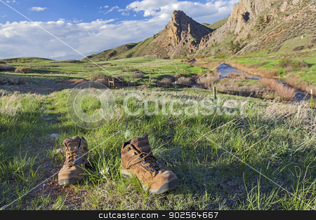 hiking boots on trail stock photo, hiking boots on a trail -  Eagle Nest Rock Open Space in Colorado at springtime by Marek Uliasz