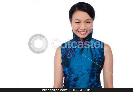 Young attractive chinese woman in blue dress stock photo, Attractive smiling girl dressed in shiny sleeveless blue attire by Ishay Botbol