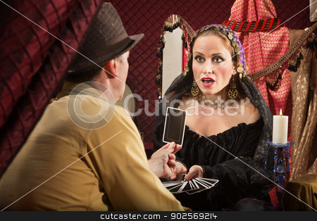 Surprised Tarot Card Reader stock photo, Shocked European fortune teller looking at tarot card by Scott Griessel