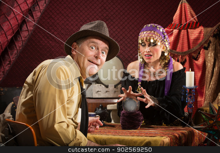 Businessman with Good Fortune stock photo, Smiling businessman getting his fortune from pretty gypsy woman by Scott Griessel