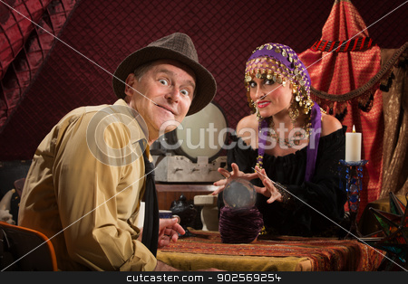 Man with Good Luck stock photo, Excited Caucasian man with grinning crystal ball reading lady by Scott Griessel