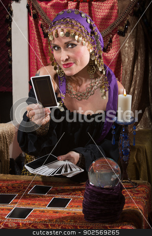 Fortune Teller Dealing Tarot Cards stock photo, Pretty female gypsy fortune teller with tarot cards by Scott Griessel