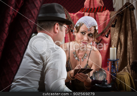 Sexy Tarot Card Reader stock photo, Sexy Caucasian tarot card reader with male customer by Scott Griessel