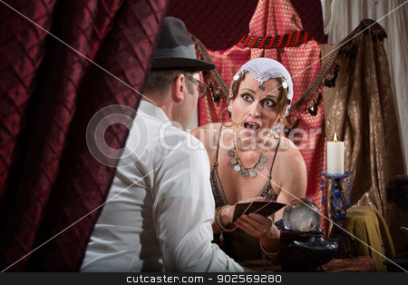 Surprised Fortune Teller stock photo, Surprised fortune teller with customer and tarot cards by Scott Griessel