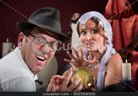 Man Getting Bad Luck stock photo, Unlucky sneering man with fortune teller and crystal ball  by Scott Griessel