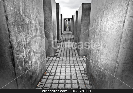 Jewish Holocaust Memorial, Berlin Germany stock photo, Jewish Holocaust Memorial, Berlin Germany with a low angle view of the passage between the large concrete slabs or stelae by Joshua Rablin