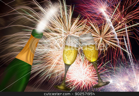 Champagne Toast with Fireworks Background stock photo, Champagne Bottle and Two Flutes Toasting with Fireworks Background by Jit Lim